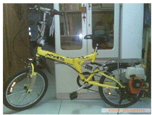 拆发动机的折叠自行车图片
